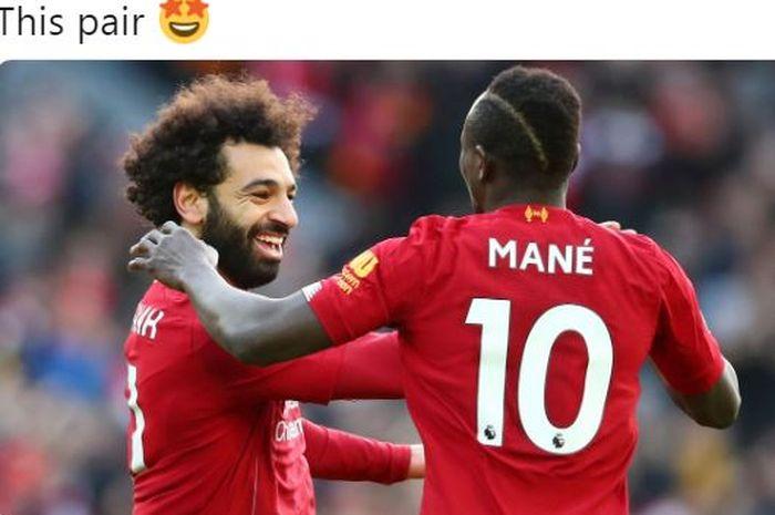 Penyerang Liverpool, Mohamed Salah, melakukan selebrasi bersama Sadio Mane.