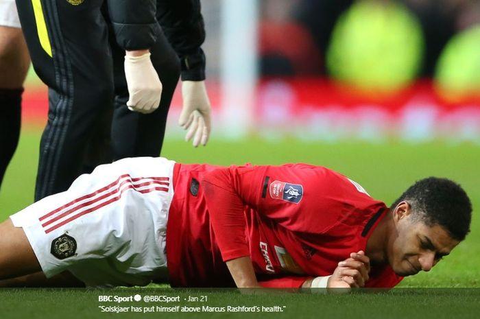 Marcus Rashford menderita cedera punggung kala membela Manchester United melawan Wolves pada babak ketiga Piala FA.