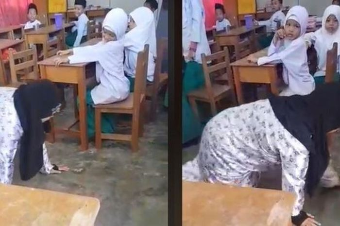 Potongan video yang memperlihatkan seorang guru tengah dihukum