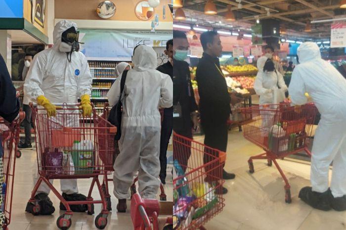 viral warga menggunakan APD untuk belanja di tengah kelangkaan alat perlindungan diri tersebut