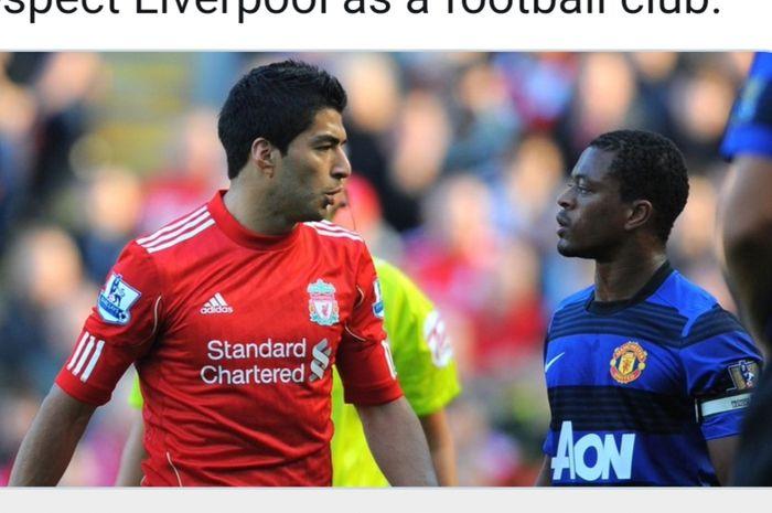 Bek kiri Manchester United, Patrice Evra (kanan), bertatapan dengan striker Liverpool, Luis Suarez.