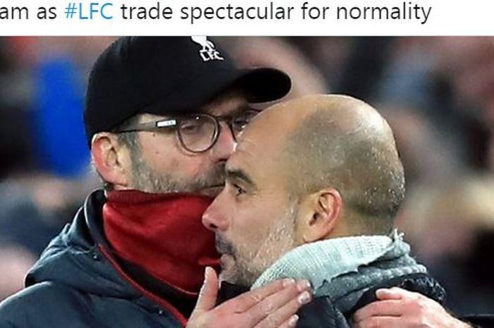Pelatih Liverpool, Juergen Klopp, memeluk juru taktik Manchester City, Pep Guardiola.