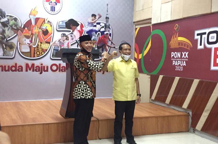 Ketua Umum PSSI, Mochamad Iriawan dan Menpora, Zainudin Amali, dalam konferensi pers mengenai persiapan Piala  Dunia U-20 2021.
