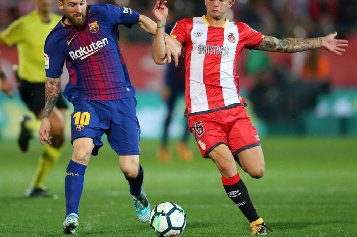 Bek sayap Girona, Pablo Maffeo, menghadapi megabintang Barcelona, Lionel Messi.