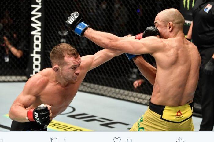 Laga Petr Yan (hitam) kontra Jose Aldo (kuning) di UFC 251, Minggu (12/7/2020).