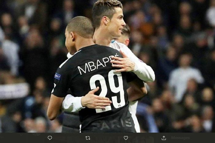 Cristiano Ronaldo memeluk Kylian Mbappe dalam duel Real Madrid vs PSG di Liga Champions.
