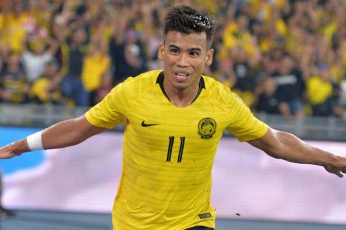 Bintang Malaysia Safawi Rasid selebrasi usai membobol gawang Timnas Indonesia dalam Kualifikasi Piala Dunia 2022 di Stadion Nasional Bukit Jalil, Kuala Lumpur, 19 November 2019.