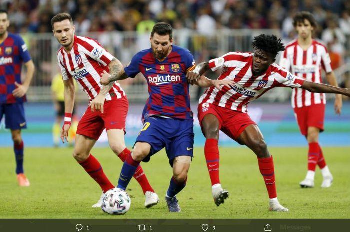 Aksi Lionel Messi (tengah) ketika Barcelona menghadapi Atletico Madrid.
