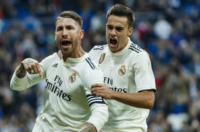 Kapten Real Madrid, Sergio Ramos bersama bek Tottenham Hotspur, Sergio Reguilon.