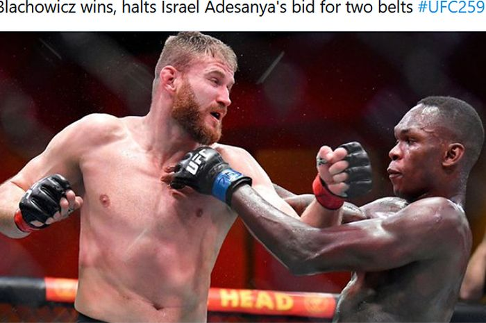 Momen duel UFC 259 bulan Maret tahun 2021 lalu saat, Israel Adesanya (kanan) dikoyak monster Polandia, Jan Blachowicz (kiri).