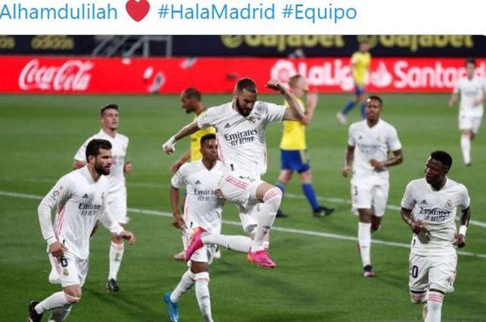 Striker Real Madrid, Karim Benzema, merayakan gol yang dicetak ke gawang Cadiz dalam laga Liga Spanyol di Stadion Ramon de Carranza, Rabu (21/4/2021).