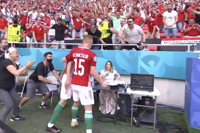 Reaksi salah seorang presenter TV wanita usai Hungaria mencetak gol pembuka ke gawang Prancis alam matchday kedua Grup F EURO 2020 di Puskas Arena pada Sabtu (19/6/2021)