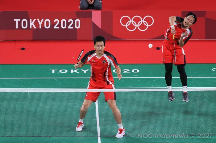Pasangan ganda putra Indonesia, Mohammad Ahsan/Hendra Setiawan, pada laga kedua penyisihan grup Olimpiade Tokyo 2020, Senin (26/7/2021).