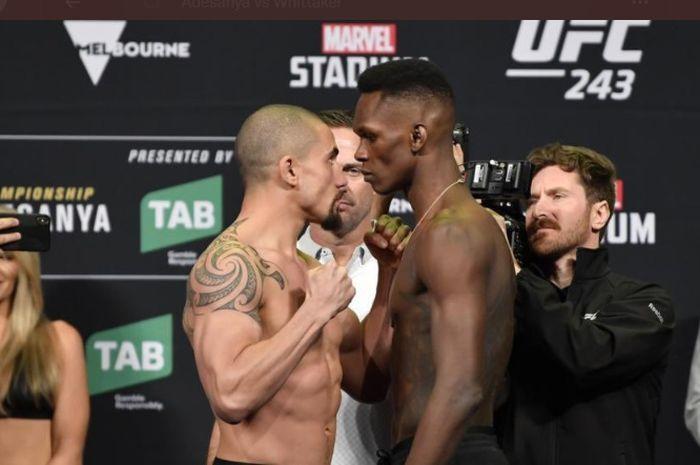 Sesi staredown Robert Whittaker (kiri) vs Israel Adesanya (kanan) dalam gelaran UFC 243
