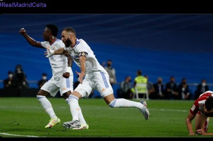 Gaya selebrasi striker Real Madrid, Karim Benzema, usai menjebol gawang Celta Vigo