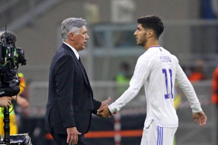 Pelatih Real Madrid, Carlo Ancelotti dan Marco Asensio.