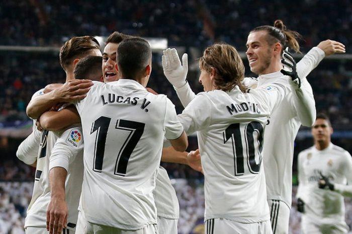 Pemain Real Madrid merayakan gol dalam laga Liga Spanyol pekan ke-14 kontra Valencia, Minggu (2/12/2018) dini hari WIB di Stadion Santiago Bernabeu. Pada gelaran Liga Champions musim ini Real Madrid tak dijagokan alias menjadi tim underdog.
