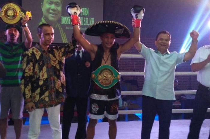 Petinju Indonesia kelas featherweight, James Mokoginta, meraih kemenangan TKO pada ajang Indonesia Pride di Markas Embrio Cafe, Jakarta, Minggu (13/5/2018).
