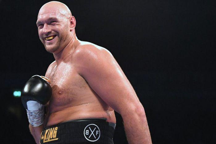 Ekspresi Tyson Fury (Inggris) setelah mengalahkan Sefer Seferi (Albania) di Manchester Arena, Inggris pada Sabtu (9/6/2018) waktu setempat.
