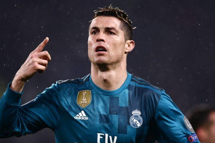 Megabintang Real Madrid, Cristiano Ronaldo, merayakan gol yang dicetak ke gawang Juventus dalam laga leg pertama perempat final Liga Champions di Stadion Allianz, Turin, Italia pada 3 April 2018.