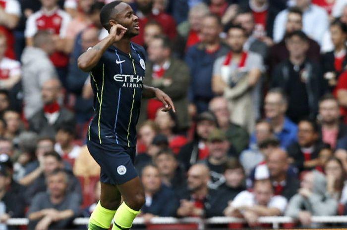 Selebrasi penyerang Manchester City, Raheem Sterling, saat merayakan gol ke gawang Arsenal dalam laga Liga Ingris 2018-2019 di Stadion Emirates, London, Inggris, pada Minggu (12/8/2018).