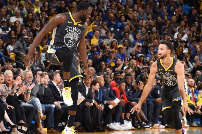 Ekspresi Draymond Green dan Stephen Curry saat memperkuat Golden State Warriors dalam laga NBA 2018/