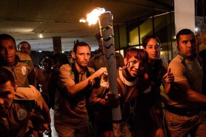 Kegiatan torch relay atau pawai obor saat Olimpiade Rio 2016.