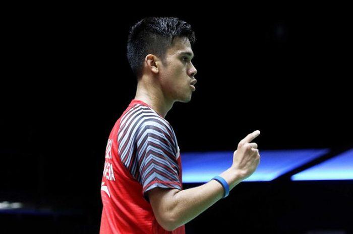 Pebulu tangkis tunggal putra Indonesia, Firman Abdul Kholik, bereaksi pada partai ketiga penyisihan terakhir Grup B Piala Thomas 2018 melawan Korea Selatan di Impact Arena, Bangkok, Thailand, Rabu (23/5/2018).