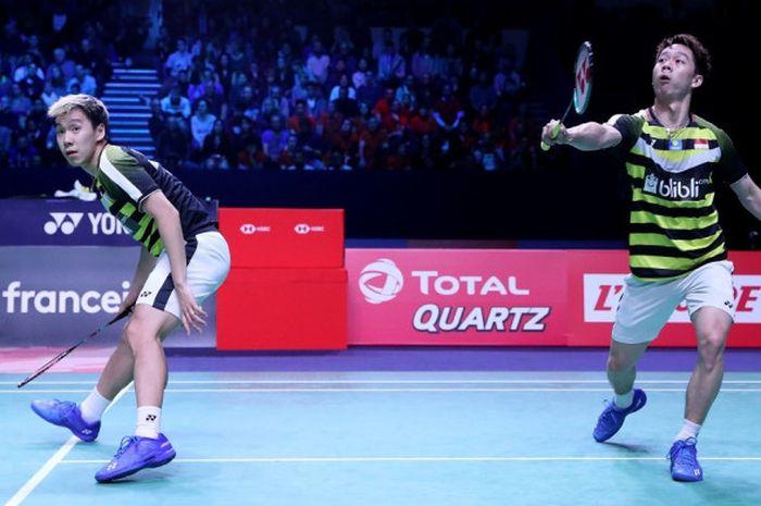 Aksi ganda putra Indonesia, Marcus Fernaldi Gideon/Kevin Sanjaya Sukamuljo, saat tampil pada partai final French Open 2018 yang digelar Minggu (28/10/2018)