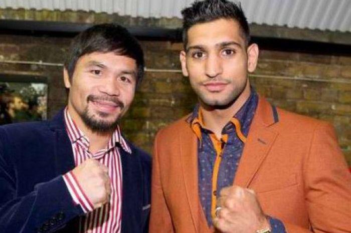 Manny Pacquiao (kiri) dan Amir Khan (kanan).