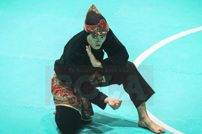 Aksi Puspa Arumsari di Padepokan Pencak Silat TMII berujung medali emas ke-13 bagi Indonesia pada Asian Games 2018, 27 Agustus 2018.