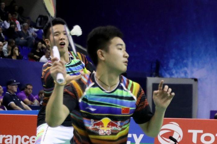 Ganda putra China, He Jiting (belakang)/Tan Qiang