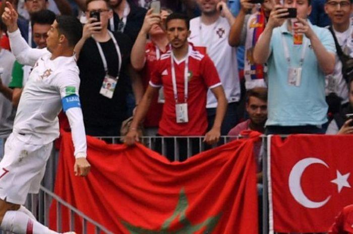 Kapten Portugal, Cristiano Ronaldo, merayakan golnya ke gawang Maroko pada pertandingan Grup B Piala Dunia 2018 di Stadion Luzhniki, 20 Juni 2018.