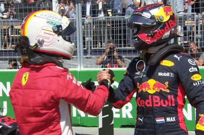 Sebastian Vettel dan Max Verstappen berjabat tangan usai sesi kualifikasi GP Canada, Minggu (10/6/2018).