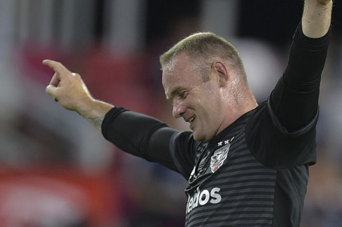 Striker DC United, Wayne Rooney, saat merayakan salah satu gol timnya menghadapi Vancouver Whitecaps FC dalam laga Major League Soccer 2018 di Stadion Audi Field , Washington DC, Amerika Serikat, pada  14 Juli 2018.