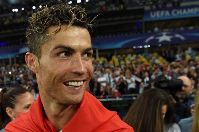 Megabintang Real Madrid, Cristiano Ronaldo, merayakan kemenangan timnya atas Liverpool FC dalam laga final Liga Champions di Stadion NSC Olimpiyskiy, Kiev, Ukraina pada 26 Mei 2018.
