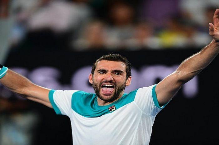 Ekspresi Marin Cilic usai memenangi laga atas Kyle Edmund pada semifinal Australian Open 2018 yang digelar Kamis (25/1/2018)