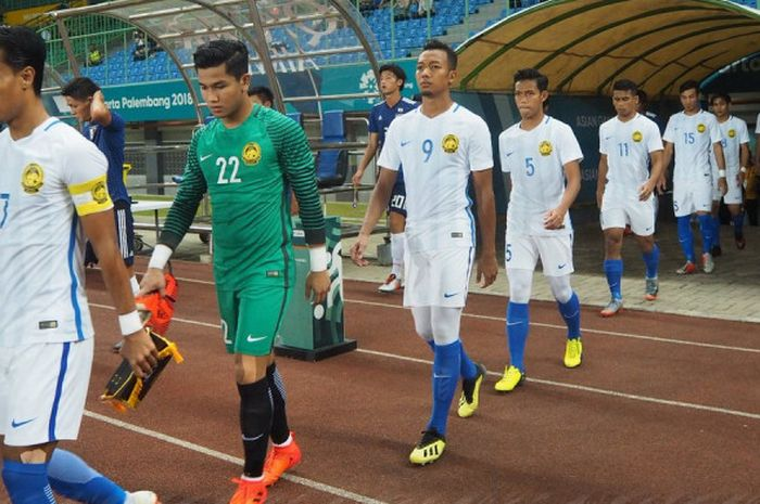 Para pemain timnas U-23 Malaysia saat bertanding melawan timnas U-23 Jepang  dalam babak 16 besar Ai