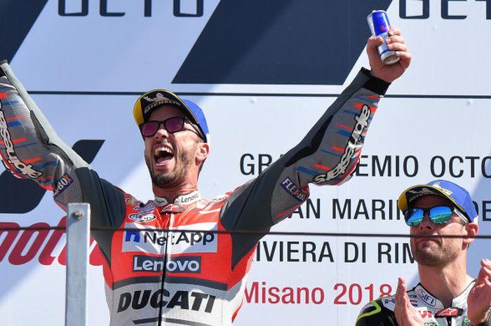 Pebalap MotoGP dari tim Ducati, Andrea Dovizioso, merayakan kemenangannya di GP San Marino, 9 September 2018 di Sirkuit Misano.