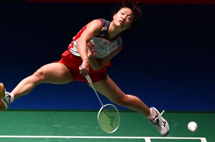 Pebulu tangkis Jepang, Nozomi Okuhara, beraksi pada laga semifinal Japan Open kontra Carolina Marin pada 16 September 2018 di Tokyo, Jepang.