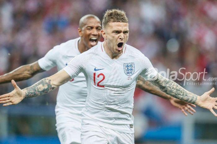 Bek sayap Inggris, Kieran Trippier, merayakan golnya ke gawang Kroasia dalam pertandingan semifinal Piala Dunia 2018.