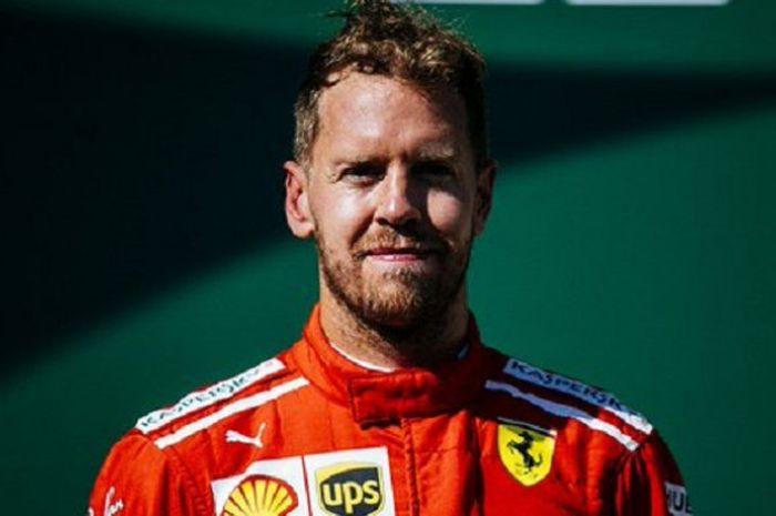 Sebastian Vettel (Ferrari) saat berada di podium usai balapan F1 GP Hongaria 2018 berakhir, Minggu (29/7/2018).