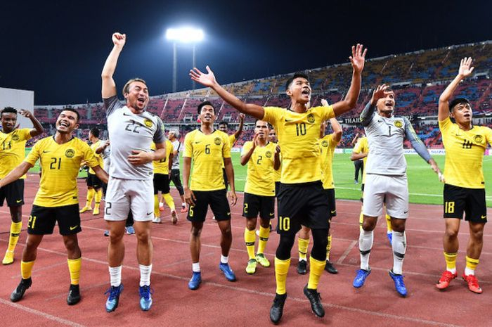Pemain timnas Malaysia merayakan kelolosan ke babak final Piala AFF 2018, Rabu (5/12/2018).