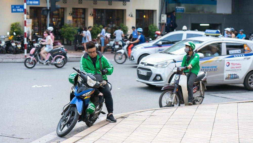 Gambaran driver Grab yang sedang beroperasi di Vietnam