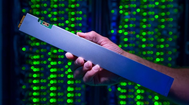 The ruler-shaped PCIe-based QLC Intel SSD D5-P4326 can hold up to 32 terabytes. As part a 1PB solution, it draws just one-tenth the power of a traditional spinning hard drive solution. (Credit: Walden Kirsch/Intel Corporation)