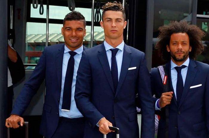 Cristiano Ronaldo diantara Casemiro (kiri) dan Marcelo Vieira