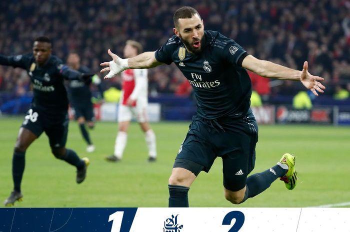 Penyerang Real Madrid, Karim Benzema, merayakan gol yang dicetak ke gawang Ajax Amsterdam dalam laga leg pertama babak 16 besar Liga Champions di Stadion Johan Cruijff ArenA, Rabu (13/2/2019).