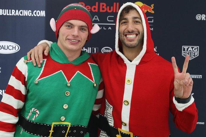 Daniel Ricciardo (kanan) dan rekan setimnya Max Verstappen siap-siap  merayakan Hari Natal 19a08fc0df