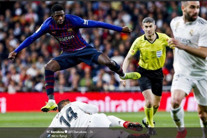 Aksi pemain Barcelona, Ousmane Dembele, dalam duel melawan Real Madrid di Estadio Santiago Bernabeu, Sabtu (2/3/2019)