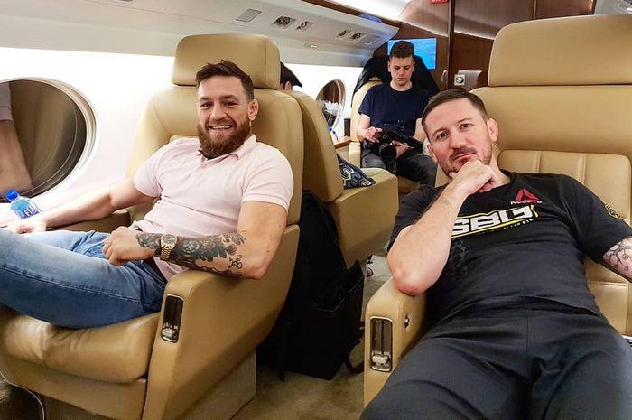 Bintang UFC, Conor McGregor dan John Kavanagh pelatihnya.